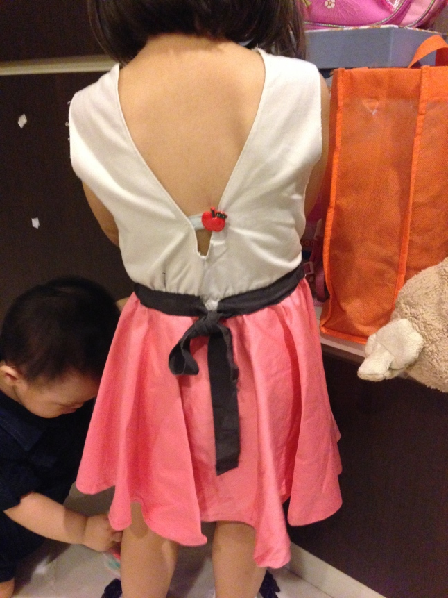 V-back beige bodice with salmon pink skater skirt