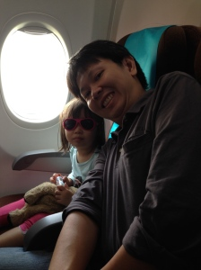 Babiators in popstar pink on plane ride